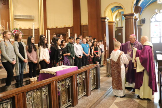 Bishop DiMarzio, assisted by pastor Father Anthony Sansone, blessed the teens of the parish.