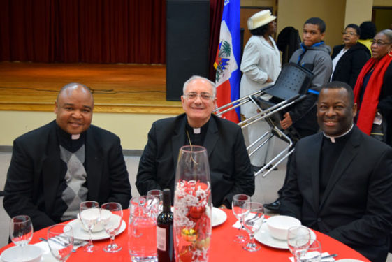 Bishop DiMarzio with Haitian priests, Father Jean Francois Nixon, left, and Father Jean-Miguel Auguste.