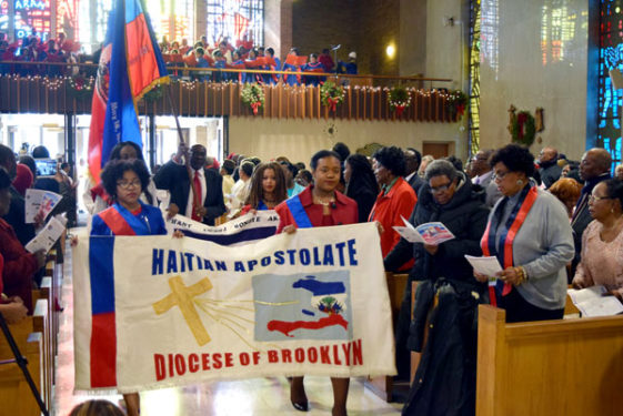 The Haitian flag was carried in and placed on the altar by representatives of the Haitian Apostolate.