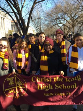 Students from Christ the King H.S., Middle Village, carried their school banner.