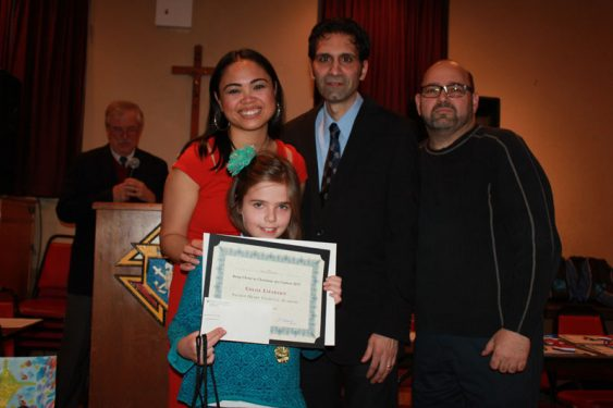 Third Grade Winner Chloe Lirarakis with Knights of Columbus and Youth Editor Melissa Enaje.