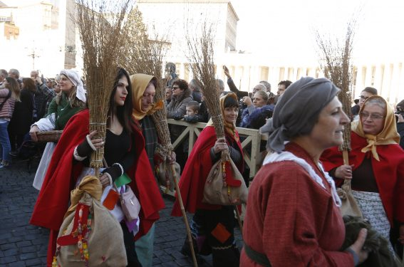 Women dressed as the Befana participate in a parade marking the feast of the Epiphany in St. Peter's Square at the Vatican. Italian legend maintains the Befana fills the stockings of good children with treats and candy the night before Epiphany but has been known to bring coal for naughty children. (CNS photo/Paul Haring)