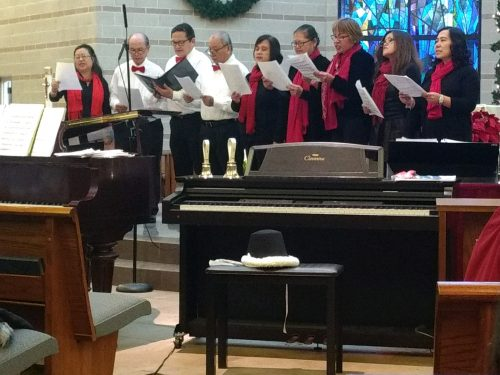 Determined to not let harsh winter weather stand in their way of celebrating the feast of the Epiphany, Our Lady of the Snows parish, N. Floral Park, held a Renaissance-style concert. The parish's Indian Apostolate Choir, Himing At Alay, Children's, Hand Bell and Adult choirs performed in honor of the Magi visiting the newborn King. Not forgetting those facing the arctic cold without the benefit of a home, parishioners brought new and slightly used men's coats for distribution in the Bowery Section of Manhattan as an offering. Photo © Anne Haffey