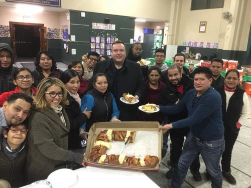 The clergy takes part in the eating of Kings Bread, a Mexican tradition.