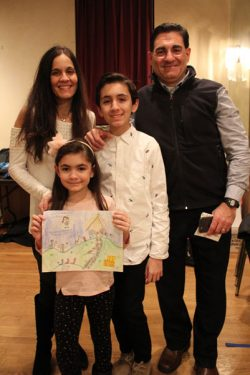 First Grade winner Nicolette Falce and her family.