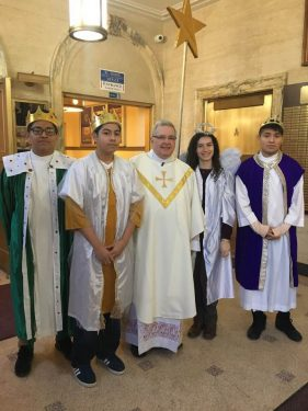 In the Basilica of Regina Pacis, Dyker Heights, a brief re-telling of the story of the Three Kings was re-enacted at the end of each Mass on the feast of the Epiphany. The Three Kings were represented by Luis Cuautle, Imanol Calixto and Ivan Cuautle. The Star was carried by Frances Reres as Msgr. Ronald Marino, rector, presided.