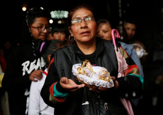 A woman holds a figurine of the Christ Child during a Mass in La Paz, Bolivia, in celebration of Three Kings' Day Jan. 6, the feast of the Epiphany. (CNS photo/David Mercado, Reuters)