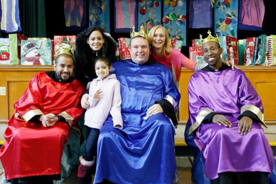 The priests of St. Sebastian's parish, Woodside, portrayed the Three Kings for the celebration of the Epiphany. Fathers Henry Torres, Kevin Abels, pastor, and Rodnev Lapommeray presented the gifts to children