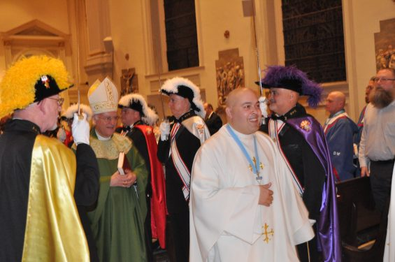 Bishop Raymond Chappetto and Father Michael Gelfant, associate state chaplain to the Knights of Columbus, pass through an honor guard of fourth-degree Knights at the annual Pro Vita Mass at St. James Cathedral-Basilica, Downtown Brooklyn.