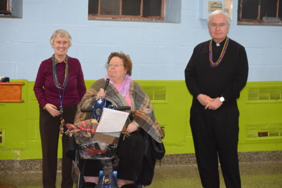 From left, Ann O'Brien, Pam Hume, and Msgr. Kevin Noone thanked everyone for coming.