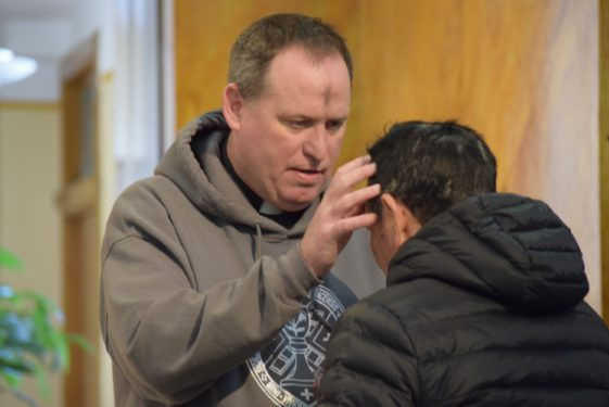 Father Kevin Sweeney, pastor of St. Michael's parish, Sunset Park, distributed ashes to parishioners at his Brooklyn church.