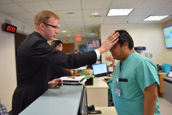 After distributing ashes at St. Michael's Church, Sunset Park, seminarian Brendon Harfmann brought the sacramental to the staff and patients at Calvary Hospital, at NYU-Lutheran Hospital Center in Sunset Park.