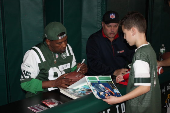 Former NFL pros Sean Landeta, right, and Wesley Walker, left, were special guests at the St. Kevin's Youth Guild football clinic. Photos Jim Mancari