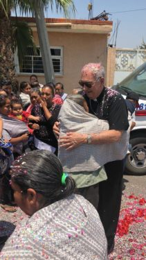 Bishop Nicholas DiMarzio visited Tlapanalá and Tejupa, which are among the areas most affected by the 2017 earthquake, to get a first-hand look at the situation in two towns still recovering from the natural disaster. In Tlapanalá, the bishop was warmly received with a shower of rose petals and confetti. Below, Bishop DiMarzio in front of the statue of St. Nicholas at the Immaculate Conception Cathedral in Puebla. Photos Fr. Jorge Ortiz