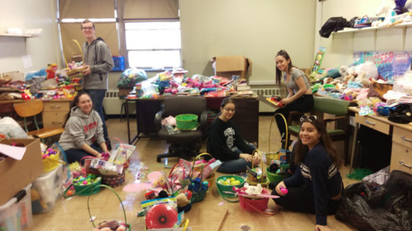 St. John's Prep Dancers Ariana Scalici (left) and Francesca Alaimo (right) and Lilly Alaimo (far right) with the 161 baskets headed to homeless children.