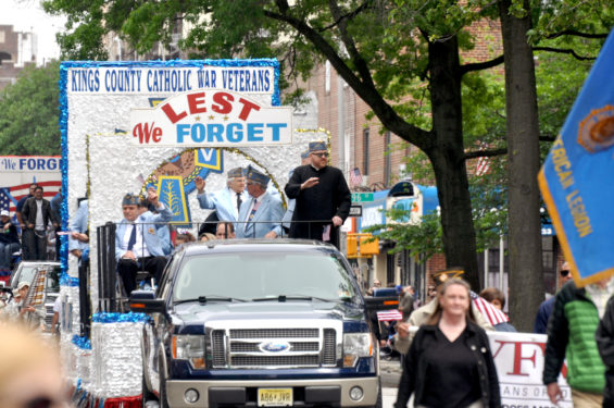 The 151st annual Memorial Day Parade in Bay Ridge drew larger crowds and reported more participants than recent years. Father Stephen Saffron, parochial vicar at St. Anselm's parish, was on the float of the Kings County Catholic War Veterans.