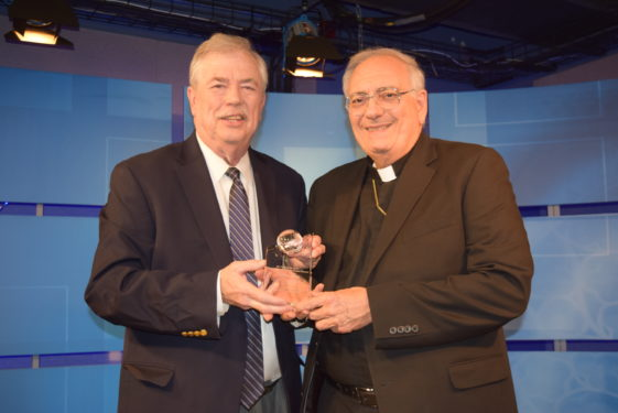 Tablet Editor Ed Wilkinson received this year's St. Francis De Sales Distinguished Communicator Award from Bishop Nicholas DiMarzio.