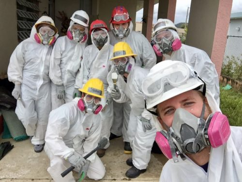 Members of Catholics Care and All Hands and Hearts don special gear during a mold sanitization project during their recent mission to aid the people of the hurricane devastated region of Yabucoa, Puerto Rico.