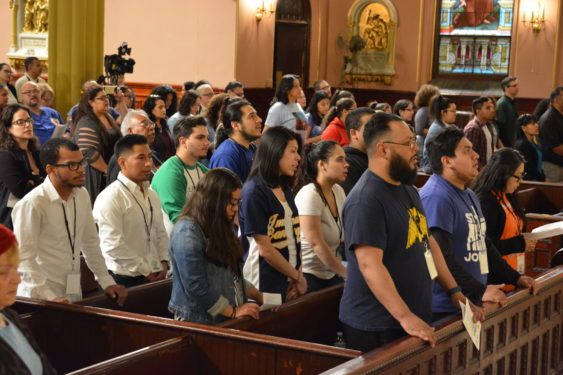 At the Jornada Mass at the Transfiguration parish in Williamsburg, three generations of Hispanic Catholics shared the celebration with bilingual prayers and hymns. Photos Jorge Dominguez