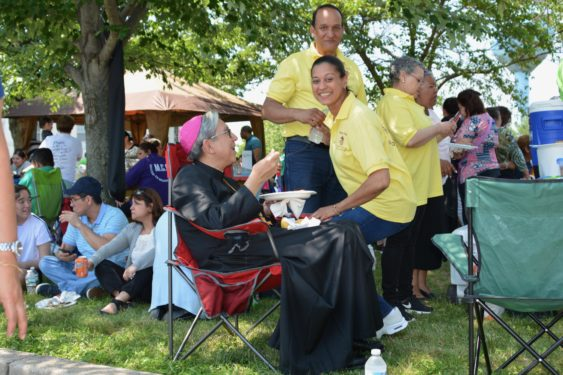 Bishop Octavio Cisneros relaxes during a picnic lunch and chats with some of the 2,000 members of the Cursillo movement who participated in the Ultreya de Campo at the National Shrine of Our Lady of Czestochowa in Doylestown, Pa.