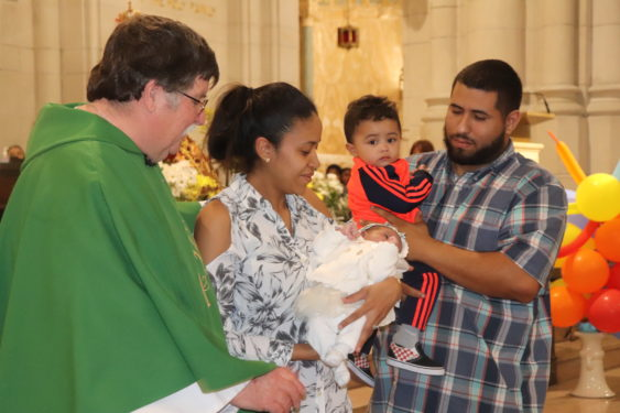 Father McKenna invited the youngest member of the congregation, Gianna, and her family to the altar for a special blessing during his homily.