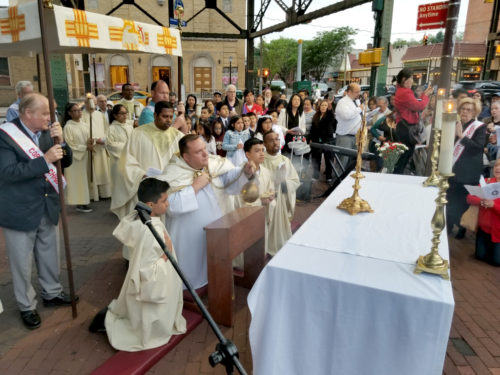 St. Sebastian parish held its 11th annual procession through Woodside with Father Kevin Abels, pastor, carrying the Blessed Sacrament in procession with parishioners, parish groups and neighbors. Photo Patrick Sweeney