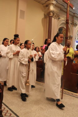Youth lead the procession for the anniversary Mass at St. John the Baptist.