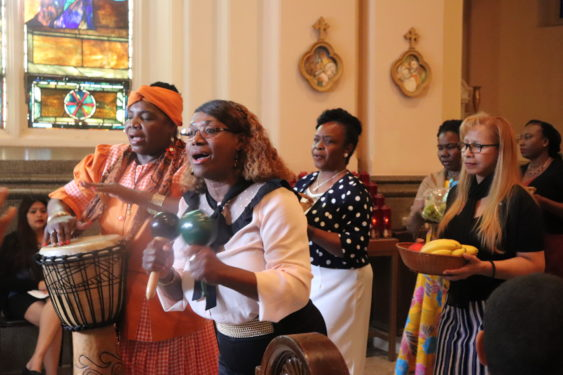 Parishioners shared their rich traditions during Mass, including a special offering of fruit and gifts while native drums played in the background during the 150th  anniversary liturgy at St. John the Baptist, Bedford-Stuyvesant, June 24.