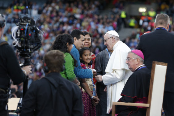 Pope Francis meets with a family that gave testimony during the Festival of Families in Croke Park stadium in Dublin Aug. 25. (CNS photo/Paul Haring)
