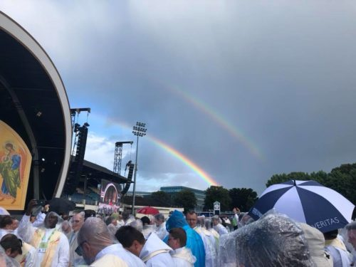 The luck of a double rainbow appears in the sky as people wait for Pope Francis' arrival at Phoenix Park in Dublin, Ireland, Aug. 26.