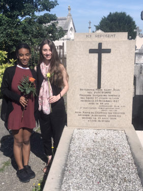 This summer, Veronique Mathieu, a recent graduate of St. Joseph's College, Clinton Hill, attended a pilgrimage to Le Puy, France. One of the sites she visited was the grave of Mother St. John Fontbonne, a foundress and first superior general of the Sisters of St. Joseph. Mathieu, far left, is seen with Tatiana Belanich from St. Joseph's College, Patchogue, L.I. (Photo courtesy St. Joseph's College)