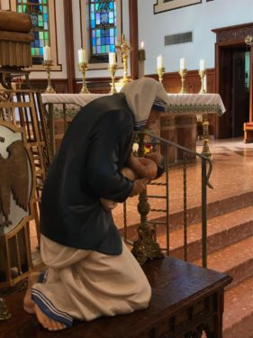 The saint's statue was placed by the altar on her feast day at Blessed Virgin Help of Christians, Woodside.