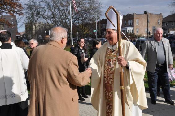 Bishop greets Bob Golden