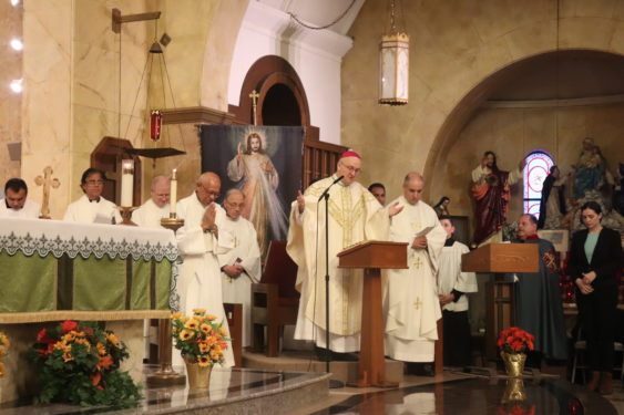 Auxiliary Bishop James Massa celebrates the jubilee Mass, and Father Thomas Vassalotti, pastor, stands to the right.
