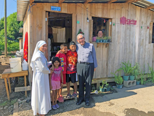 Auxiliary Bishop Octavio Cisneros with one of the Missionaries of the Risen Christ and three of the children living in Pope Francis Shelter. (Photos Bishop Octavio Cisneros)