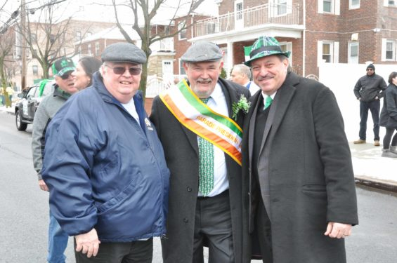 Caruana. Above right, Mike Benn, President of the Parade, is flanked by Father William Sweeney, pastor of St. Francis de Sales parish, and State Senator Joseph Addabbo.