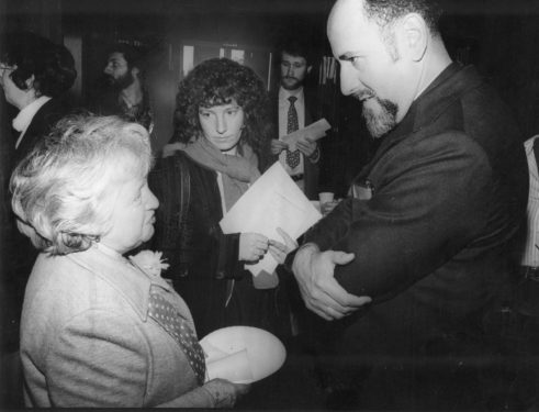 The bishop converses with women at a 1982 meeting protesting federal buget cuts to senior citizens.