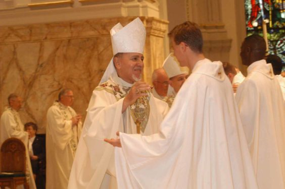 Bishop Valero offers a sign of peace to newly-ordained Father Richard Zuk during ordination ceremony at St. James Cathedral-Basilica in 2005.