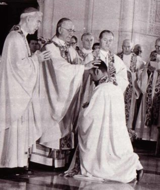Bishop Francis J. Mugavero lays hands on the head of Bishop Valero during episcopal ordination ceremony in 1980.