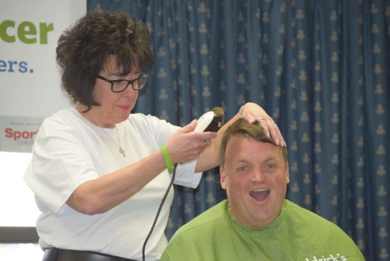 St. Francis Prep teacher Brian McCormack has his head shaved.