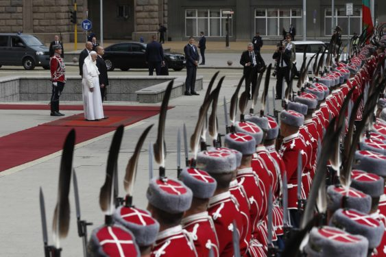 Pope Francis stands next to Bulgarian President Rumen Radev during a welcoming ceremony in the square outside the presidential palace.