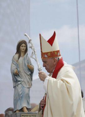 Pope Francis passes a Marian statue as he arrives to celebrate Mass at Macedonia Square in Skopje.