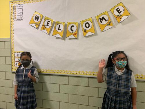 Second graders Emily Morales and Megan Pinnock at Midwood Catholic Academy, Flatlands (Photo: Erin DeGregorio)