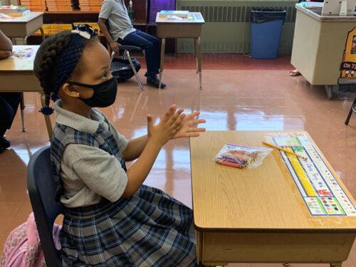 First grader Lynn-Claris Fevry at Midwood Catholic Academy, Flatlands (Photo: Erin DeGregorio)
