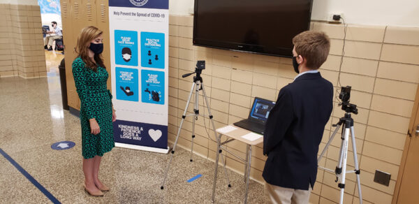 Joelle Roussine, left, assistant principal at St. Mary's High School, conducts digital health checks for students upon arrival to Immaculata Hall each morning.