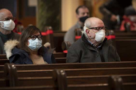 Those in attendance during the Ash Wednesday Mass sit in socially distanced pews at St. James Cathedral, Downtown Brooklyn.